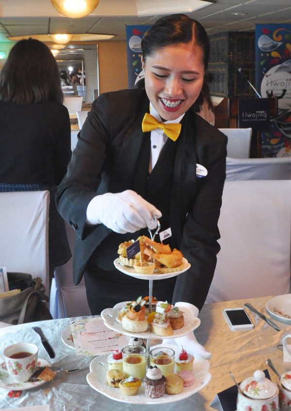 royal high tea superstar libra cruise serving food