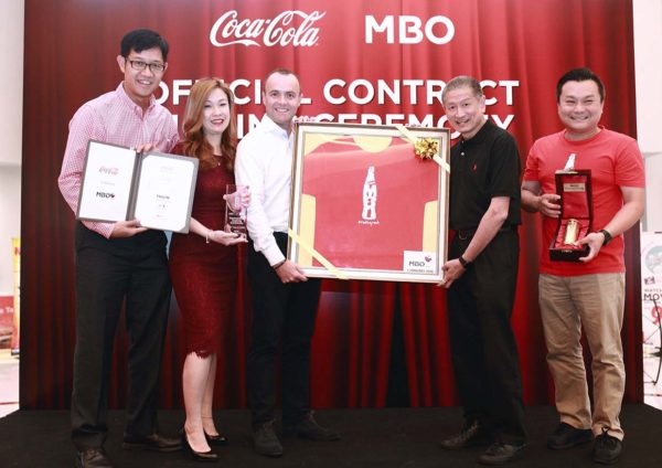 mbo cinemas coca-cola beverages signing ceremony gold can