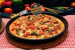 new and improved pan pizza from pizza hut meat lover's pesto